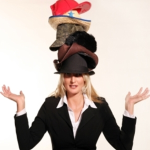 woman wearing multiple hats