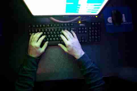 Hands typing on a computer