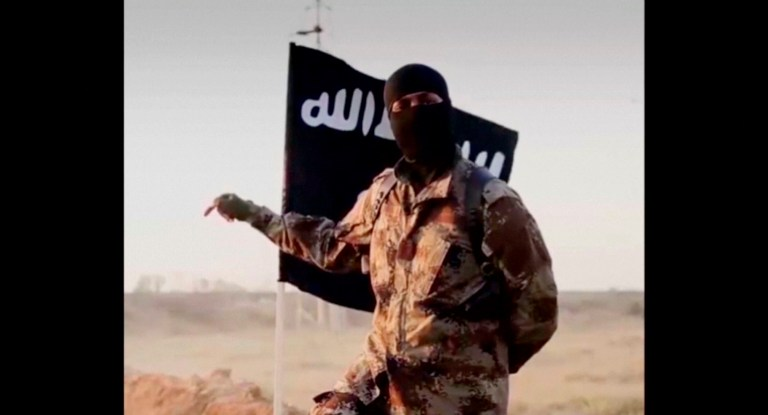 A masked man speaking in what is believed to be a North American accent in a video that Islamic State militants released in September 2014 is pictured in this still frame from video obtained by Reuters October 7, 2014. The FBI said October 7, 2014 it was seeking information on the man's identity, and issued an appeal for help in identifying individuals heading overseas to join militants in combat. REUTERS