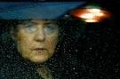 Angela Merkel looks out a rainy window.