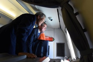 U.S. Secretary of Defense Ash Carter and Singapore's Minister of Defence Ng Eng Hen look through the window of a P8 aircraft above the Singapore Straits June 3, 2016. U.S. Department of Defense/Handout via REUTERS ATTENTION EDITORS - THIS IMAGE WAS PROVIDED BY A THIRD PARTY. EDITORIAL USE ONLY. TPX IMAGES OF THE DAY - RTX2FG3N