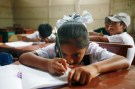 Reuters/Enrique Castro - Students attend a class in school in Pachacutec shanty town northern Lima March 1, 2012.