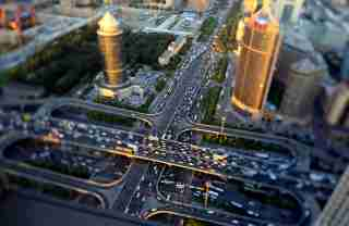 Vehicles drive on the Guomao Bridge during the evening rush hour in Beijing, September 3, 2014. Picture taken using a tilt shift lens. REUTERS/Jason Lee (CHINA - Tags: BUSINESS TRANSPORT) - RTR44SX2