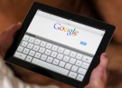 An illustration picture shows a woman holding her Apple Ipad tablet which displays a tactile keyboard under the Google home page in Bordeaux, Southwestern France, February 4, 2013.  REUTERS/Regis Duvignau (FRANCE - Tags: SCIENCE TECHNOLOGY BUSINESS) - RTR3DCJL