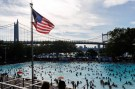 "People enjoy a day in the pool during a heat wave called ""Heat Dome"" in the Astoria borough of New York, U.S., July 24, 2016. REUTERS/Eduardo Munoz - RTSJFZU"