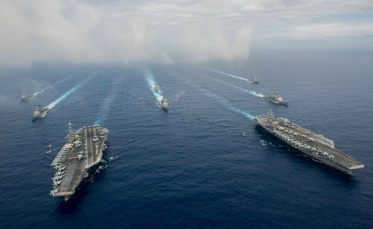 The Nimitz-class aircraft carriers USS John C. Stennis (CVN 74), and USS Ronald Reagan (CVN 76) (R) conduct dual aircraft carrier strike group operations in the U.S. 7th Fleet area of operations in support of security and stability in the Indo-Asia-Pacific in the Philippine Sea on June 18, 2016. Courtesy Jake Greenberg/U.S. Navy/Handout via REUTERS.
