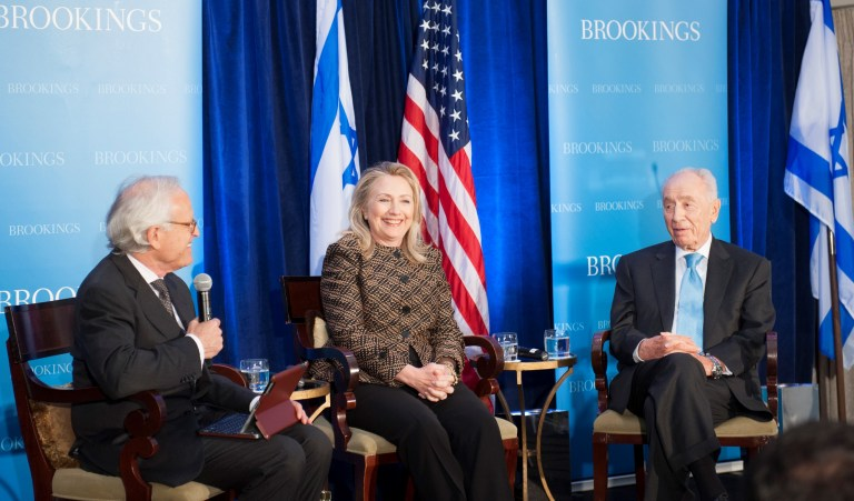 Brookings Executive Vice President Martin Indyk. U.S. Secretary of State Hillary Clinton, and former Israeli President Shimon Peres speak at an event at Brookings on June 12, 2012.