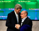 Washington Post reporter Jason Rezaian (R) is greeted by U.S. Secretary of State John Kerry at the grand opening of the Washington Post newsroom in Washington January 28, 2016. Rezaian was recently released from 18 months of captivity in Iran. REUTERS/Gary Cameron - RTX24FQ1