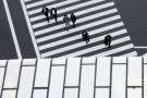 People cross a street in a business district in Tokyo, Japan, February 16, 2016. The Bank of Japan's negative interest rates came into effect on Tuesday in a radical plan already deemed a failure by financial markets, highlighting Tokyo's lack of options to spur growth as global markets sputter.  REUTERS/Thomas Peter      TPX IMAGES OF THE DAY      - RTX273XG