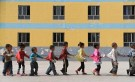 Students walk in line towards a dining hall for lunch at a primary school for children of migrant workers in Aksu, Xinjiang Uighur Autonomous Region, September 6, 2012. REUTERS/Stringer (CHINA - Tags: EDUCATION SOCIETY TPX IMAGES OF THE DAY) CHINA OUT. NO COMMERCIAL OR EDITORIAL SALES IN CHINA - RTR37K1R