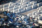 """An aerial view shows makeshift shelters, tents and containers where migrants live in what is known as the """"Jungle"""", a sprawling camp in Calais, France, September 7, 2016. Picture taken September 7, 2016.  REUTERS/Charles Platiau  TPX IMAGES OF THE DAY  - RTX2OMMO"""