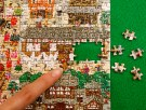 A woman points at the world's smallest 1000-piece puzzle made by Beverly Enterprises Inc. at the International Tokyo Toy Show