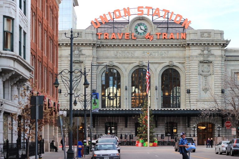 A picture looking down 17th St. towards the main facade of Denver's Union Station, decorated for the holidays. taken on December 10, 2014 by Isaac Kim (WIKIMEDIA).