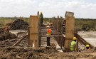 Workers construct a culvert along the Southern bypass road under construction next to the Nairobi National Park in Kenya's capital Nairobi, March 4, 2016. Kenya Wildlife Service (KWS) and the Ministry of Transport agreed to cut off about 53 acres of land from the Nairobi National Park to allow for completion of the 28 kms Nairobi Southern bypass road project.  REUTERS/Thomas Mukoya - RTS9BJ0