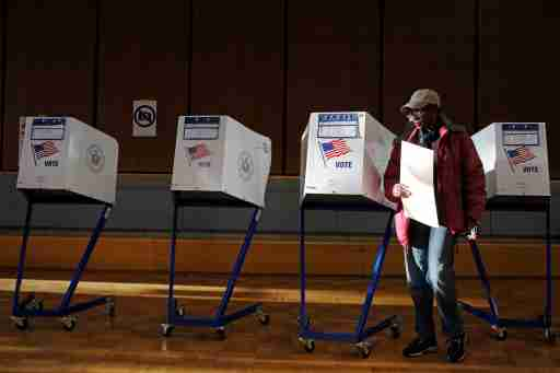 A woman exits the voting booth after filling out her ballot for the U.S presidential election at the James Weldon Johnson Community Center in the East Harlem neighbourhood of Manhattan, New York City, U.S. November 8, 2016. REUTERS/Andrew Kelly - RTX2SIHQ