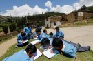 Students draw in a garden near a school in Pariaqaqa town  in Ancash November 27, 2014. REUTERS/ Mariana Bazo (PERU - Tags: SOCIETY EDUCATION) - RTR4FW5V