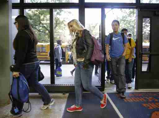 Students walk the halls at Whitney Young High School in Chicago.