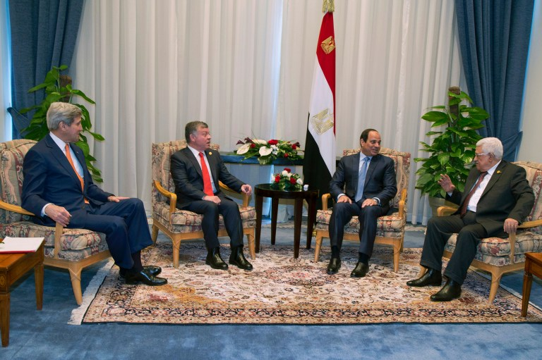 (L-R) U.S. Secretary of State John Kerry, Jordanian King Abdullah, Egyptian President Abdel Fattah al-Sisi and Palestinian President Mahmoud Abbas meet on the sidelines of the Egypt Economic Development Conference in Sharm el-Sheikh March 13, 2015. Kerry will welcome recent economic reforms by Egypt's government and press for more progress when he addresses an Egyptian investment summit in the Red Sea resort on Friday, a senior State Department official said. REUTERS/Brian Snyder (EGYPT - Tags: POLITICS BUSINESS ROYALS) - RTR4T86W