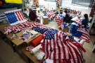 Workers at a factory in Kfar Saba near Tel Aviv sew U.S. flags that were ordered ahead of President Barack Obama's visit to Israel March 12, 2013. It was the most work the factory has had since Egyptian President Anwar Sadat visited Israel in 1977, owner Avi Marom said on Tuesday. The White House has yet to officially announce the dates for the trip, but Israeli news media have reported that Obama will arrive in Israel on March 20. REUTERS/Nir Elias (ISRAEL - Tags: POLITICS) - RTR3EVOE
