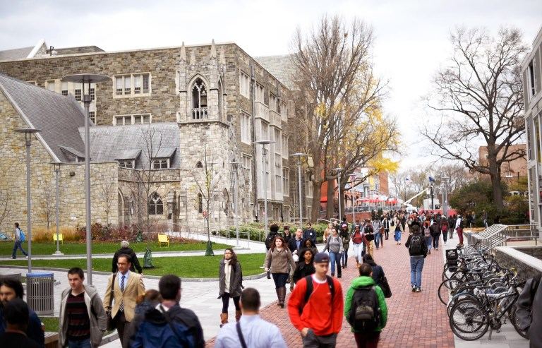 Students walk through the campus of Temple University in Philadelphia.,