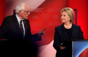 REUTERS/Mike Sega. Democratic U.S. presidential candidate Senator Bernie Sanders (L) speaks directly to former Secretary of State Hillary Clinton at a debate in 2016. The success of Sanders, a self-described socialist, in Democratic primaries highlights the divisions within the party