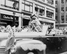 General Dwight Eisenhower waving to the crowd