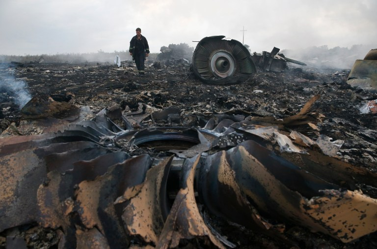 An Emergencies Ministry member walks at a site of a Malaysia Airlines Boeing 777 plane crash near the settlement of Grabovo in the Donetsk region, July 17, 2014. The Malaysian airliner flight MH17 was brought down over eastern Ukraine on Thursday, killing all 295 people aboard and sharply raising the stakes in a conflict between Kiev and pro-Moscow rebels in which Russia and the West back opposing sides. REUTERS/Maxim Zmeyev (UKRAINE - Tags: TRANSPORT DISASTER POLITICS CIVIL UNREST TPX IMAGES OF THE DAY) - RTR3Z3SK