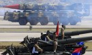 A Hatf-VI (Shaheen-II) missile (background) is displayed during the Pakistan Day parade in Islamabad March 23, 2015. Pakistan held its first Republic Day parade in seven years on Monday, full of flag-waving pomp and aerial military expertise, a symbolic show of strength in the war against the Taliban months after a militant attack on a school killed 132 children. Pakistan Day commemorates March 23, 1940, when the Muslim League demanded the establishment of separate nations to protect Muslims in the then British colony of India. REUTERS/Faisal Mahmood - RTR4UI23