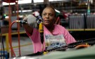 United Auto Workers union member assembly worker Ingrid Hill works on a Chevrolet Volt electric vehicle at General Motors Detroit-Hamtramck assembly plant in Hamtramck, Michigan July 27, 2011.  REUTERS/Rebecca Cook   (UNITED STATES - Tags: TRANSPORT BUSINESS EMPLOYMENT) - RTR2PCOM