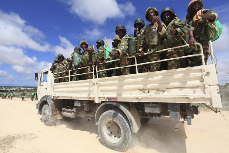 African Union Mission in Somalia (AMISOM) peacekeepers from Burundi patrol in a truck after fighting between insurgents and government soldiers erupted on the outskirts of Mogadishu in this May 22, 2012 file photo. REUTERS/Feisal Omar/Files - RTSCLRN