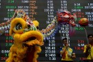 Lion and dragon dancers perform in front of an electric board at the trading floor of the Philippine Stock Exchange to celebrate the Chinese Lunar New Year of the Rooster in Makati city, Metro Manila, Philippines January 30, 2017. REUTERS/Ezra Acayan
