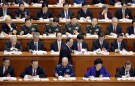 China's Politburo Standing Committee member Wang Qishan (bottom row, C), the head of China's anti-corruption watchdog, walks toward his seat during the opening session of the National People's Congress (NPC) in Beijing, China, March 5, 2016. REUTERS/Jason Lee TPX IMAGES OF THE DAY