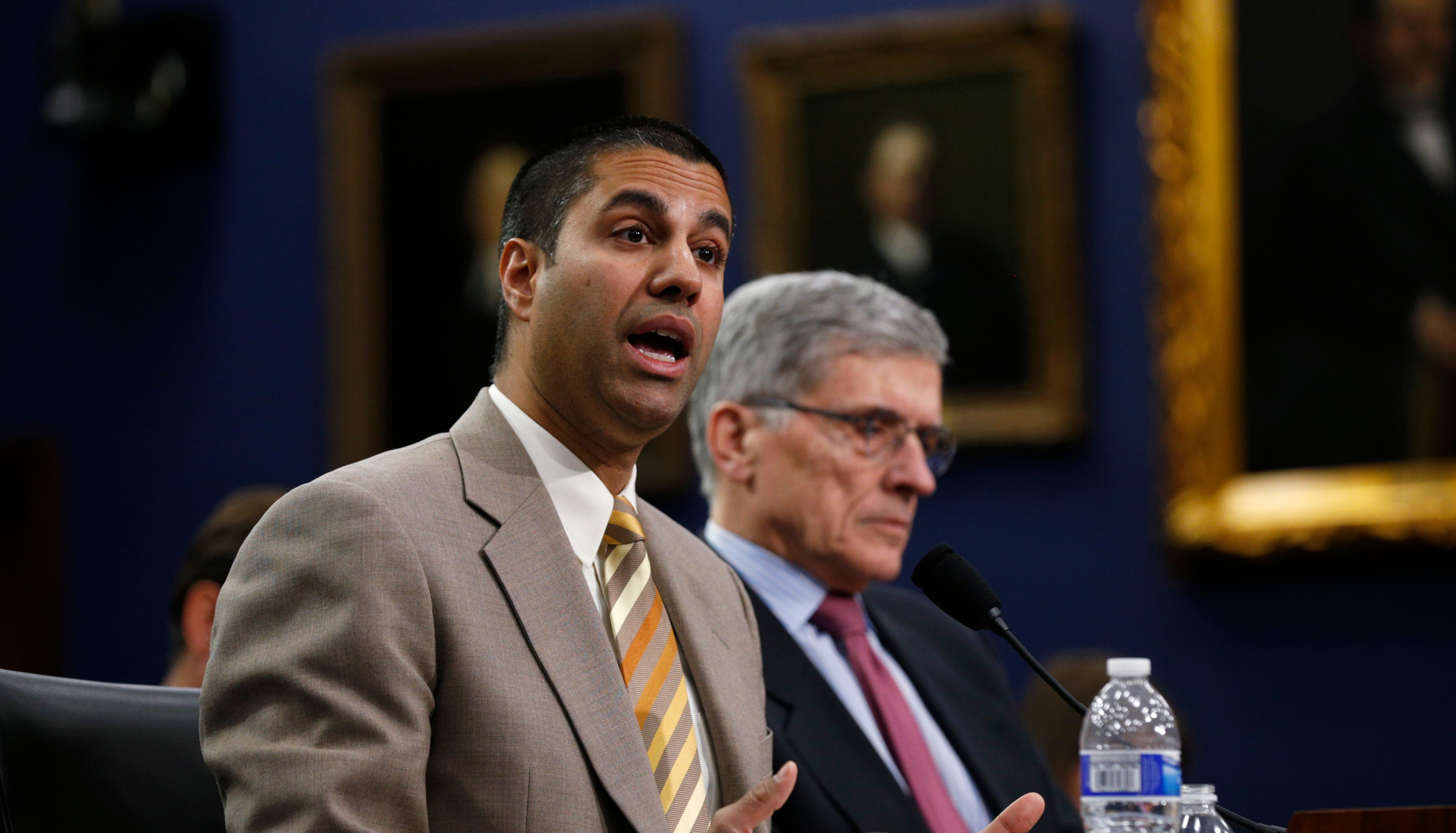 Federal Communications Commission (FCC) Commissioner Ajit Pai (L) and FCC Chairman Tom Wheeler testify at a House Appropriations Financial Services and General Government Subcommittee hearing on the FCC's FY2016 budget, on Capitol Hill