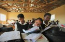 "Children write notes from a makeshift black board at a school in Mwezeni village in South Africa's Eastern Cape Province in this picture taken June 5, 2012. The Eastern Cape, home to giants of the African National Congress like Nelson Mandela and Walter Sisulu who helped end apartheid and Thabo Mbeki, the nation's second democratically elected president, is a glaring example of the ruling party's failure to deliver its promise of a ""better life for all"". While thousands of schools wait each year for textbooks and many Eastern Cape children are forced to write on loose sheets, the ANC has produced copious reams of policy papers to be studied by about 3,000 delegates at next week's meeting. Picture taken June 5, 2012. To match Insight  SAFRICA-ANC/  REUTERS/Ryan Gray (SOUTH AFRICA - Tags: EDUCATION POLITICS) - RTR343F0"
