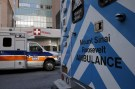 Ambulances are parked outside the emergency room entrance at Mount Sinai West Roosevelt Hospital in New York