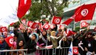 People wave national flags during celebrations marking the sixth anniversary of Tunisia's 2011 revolution in Habib Bourguiba Avenue in Tunis, Tunisia January 14, 2017. REUTERS/Zoubeir Souissi - RTSVIMM