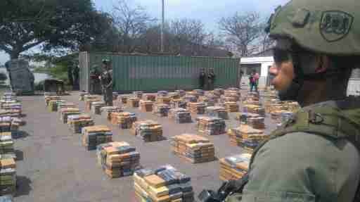 DATE IMPORTED:April 02, 2017Soldiers stand guard next to packages containing cocaine after Colombian police seized more than six tonnes of the drug, in Barranquilla, Colombia April 2, 2017. Colombian Police/Handout via REUTERS ATTENTION EDITORS - THIS PICTURE WAS PROVIDED BY A THIRD PARTY. EDITORIAL USE ONLY