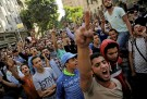 Egyptian protesters and Muslim Brotherhood members shout slogans against President Abdel Fattah al-Sisi and the government during a demonstration protesting the government's decision to transfer two Red Sea islands to Saudi Arabia, in front of the Press Syndicate in Cairo, Egypt, April 15, 2016. REUTERS/Amr Abdallah Dalsh - RTX2A5NC