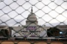 The U.S. Capitol building is seen behind a security fence in Washington, U.S., January 19, 2017. REUTERS/Shannon Stapleton - RTSWAMU
