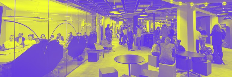 MTWTF designed cover photo of the Innovation spaces report: a modern, open office space is presented in a purple/yellow tint