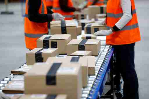 Amazon employees sort packages