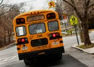 A school bus used for transporting New York City public school students is seen driving down 135th avenue in the Queens borough of New York