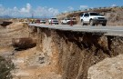Traffic passes through a section of Nevada Highway 168 near Glendale, Nevada September 9, 2014. The road and Interstate 15 were damaged by storm the runoff of Monday. REUTERS/Las Vegas Sun/Steve Marcus (UNITED STATES - Tags: DISASTER ENVIRONMENT TRANSPORT) - RTR45LGL