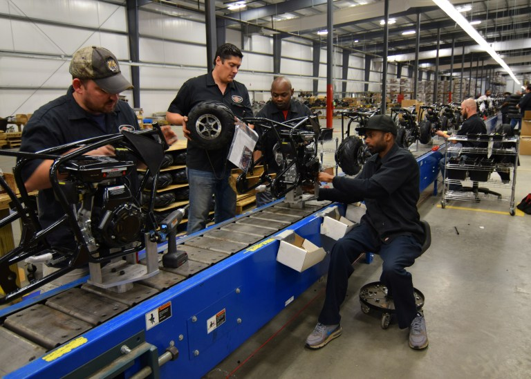 Workers construct mini-bikes at motorcycle and go-kart maker Monster Moto in Ruston
