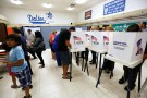 Voters cast their ballots in the Dalton Elementary School after the polling station in Azusa, California, U.S. was reopened following a shooting in the area