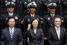 Taiwan President Tsai Ing-wen and Defence Minister Feng Shih-kuan (front row R) react as they take a group photo with navy personnel after visiting a navy base in Kaohsiung, Taiwan