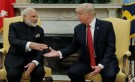 U.S. President Donald Trump (R) greets Indian Prime Minister Narendra Modi