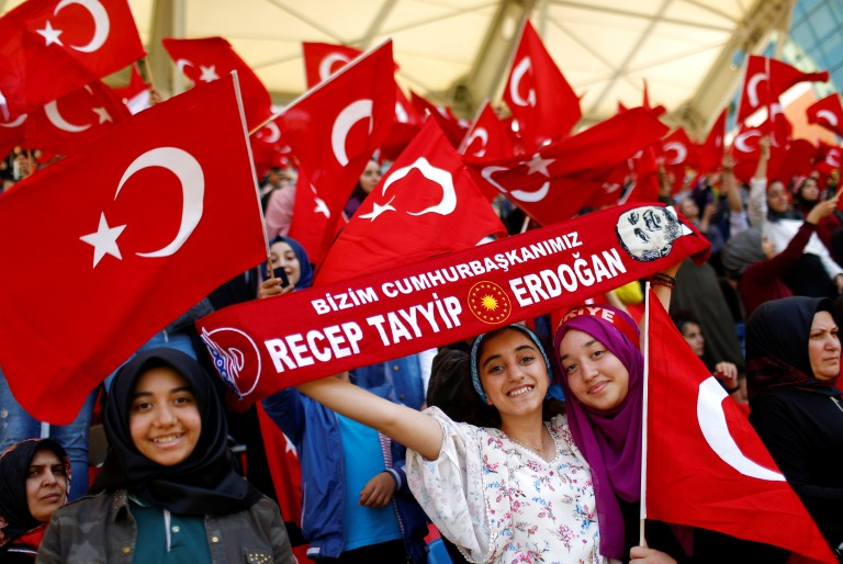 Imam Hatip religious school students wave national flags as they wait for arrival of Turkish President Tayyip Erdogan during a graduation ceremony in Istanbul, Turkey, May 26, 2017. REUTERS/Murad Sezer - RTX37SQ9