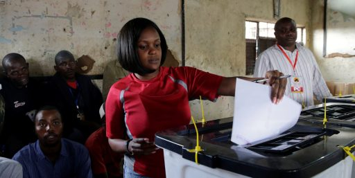 A woman casts her ballot during the Jubilee Party (JP) primary elections, inside a polling centre in Nairobi, Kenya April 26, 2017. REUTERS/Thomas Mukoya - RTS13YYA