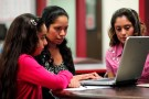 Villanueva and her 11-year-old daughter Laritza receive help on their charter school application from Barrio Logan College Institute counselor Pena in San Diego, California